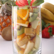 Fresh glass with fruits — Stock Photo