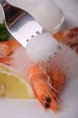 Gourmet meal,shrimp and lemon — Stock Photo