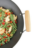 Pan with vegetables on white — Stock Photo