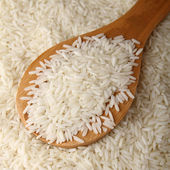 Raw rice and spoon — Stock Photo