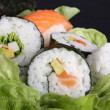 Salad and sushi — Stock Photo