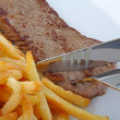 Beefsteak and french fries — Stock fotografie #9221167