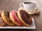 Donuts and coffee cup — Stock Photo