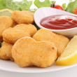 Nuggets and ketchup - Stock Photo