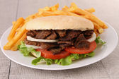Kebab and french fries — Stock Photo
