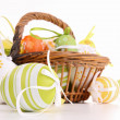 Easter egg in wicker basket — Stock Photo #9778518