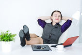 Business woman relax with legs on the table — Stock Photo