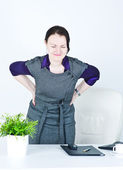 Business woman with pain in her back — Stock Photo