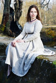 Young beautiful woman in vintage dress — Fotografia Stock