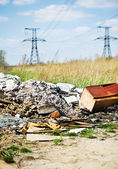 Garbage dump and power lines — Stock Photo