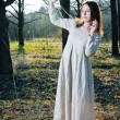 Stock Photo: Young beautiful womin long dress