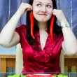 Woman with red chili peppers — Stock Photo