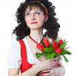 Beautiful woman in the red dress with flowers — Stock Photo