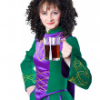 Woman in irish dancing dress with beer — Stock Photo