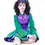 Woman irish dancer sitting — Stock Photo