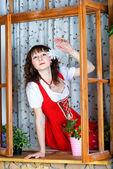Beautiful woman looking out window — Stock Photo
