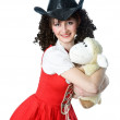 Beautiful woman in cowboy hat with the toy — Stock Photo #9162131
