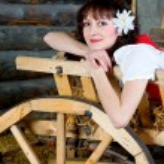 Beautiful woman lying in the cart — Stock Photo #9246689