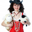Beautiful woman in cowboy hat with the toys — Stock Photo