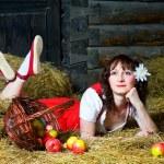 Beautiful woman lying on the hay — Stock Photo #9281447
