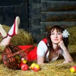 Stock Photo: Beautiful womlying on hay