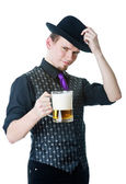Man in black hat with mug of beer — Stock Photo