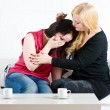 Stock Photo: Consoling by friend