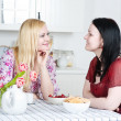 Two women talking in the kitchen — Stock Photo #9665981