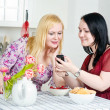 Two women talking using telephone — Stock Photo #9675321