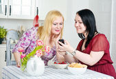 Two women talking using telephone — Stock Photo