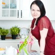 Beautiful woman in the kitchen — Stock Photo #9683776