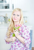 Blond woman with tulips — Stock Photo