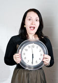 Woman showing on the clock — Stock Photo