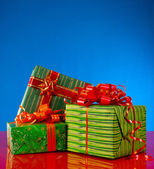Christmas presents against blue background — Stock Photo