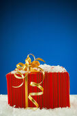 Christmas present against blue background — Stok fotoğraf