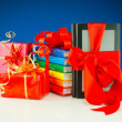 Christmas presents with electronic book reader against blue background — Stok fotoğraf