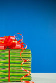 Christmas present against blue background — Foto Stock