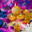 Christmas decorations and candles over blue background — Stock Photo