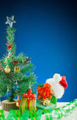 Christmas presents against blue background — Stok fotoğraf