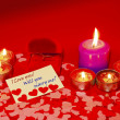 Stock Photo: Two rings and card with marriage proposal with six candles