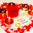 Stock Photo: Ring and card with marriage proposal with candles