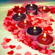 Burning candles heart shaped - Stock Photo