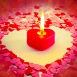 Burning red heart shaped candle - Foto de Stock