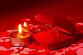 Two rings in a box and two candles — Stock Photo