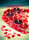 Burning candles heart shaped — Stock Photo