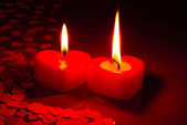 Two burning heart shaped candles — Stock Photo