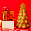 Two presents, blank card and golden evergreen tree - Stock fotografie