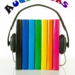 Row of books and headphones - Audiobooks concept - Stock Photo