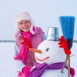 Teenage girl with snowman — Stock Photo #8758994