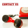 Red old fashioned telephone - Contact us concept — Stock Photo #8759377